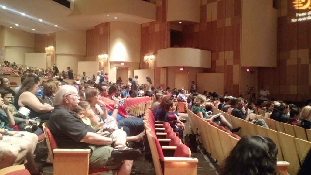 Crowd getting to their seats before the performance.
